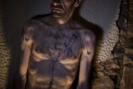 greece s muslim immigrants are ashamed of their prison tattoos vice
