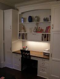 kitchen planning desk with bookshelves in almost black rye by