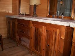 brown wooden bathroom vanity with grey marble top and double sink