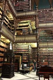 vintage photos of librarians three floors of very old books in a
