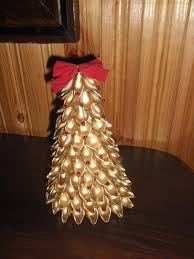 small tree decorated with gold sprayed pasta shells