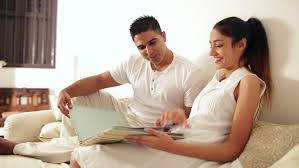 Couple Photo Album Couple Sitting On The Sofa And Watching Photo Album Stock Footage