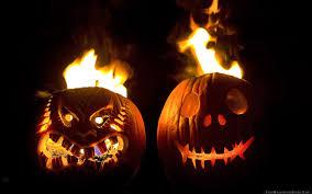 halloween holiday pumpkin faces steam fire black background