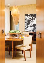 old is new again designnj a black and white oil painting makes a statement in the dining room against a cream palette that includes asymmetrically hung macrame light fixtures