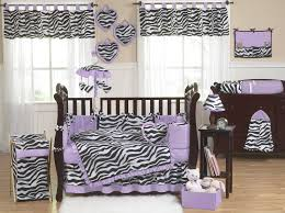 bedroom cream polished wooden baby crib using purple floral
