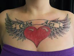 lettering wings breast by black scorpion tattoos