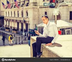 New York Travelers Stock images Man texting on wall street stock editorial photo xcai 150662108 jpg