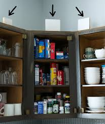 Putting Trim On Cabinets by How To Add Height To Kitchen Cabinets