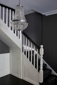 black staircase under the stairs closet transitional entrance foyer denai