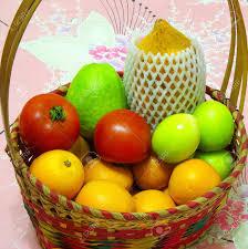 basket of fruit a basket of fruit with papaya guava orange dates and tomato stock