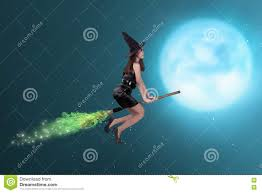 halloween full moon background pretty asian witch woman flying on the sky stock photo image