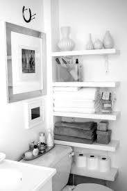 Bathroom White Shelves Floating White Wooden Four Shelves For Towels And Tissue Paced On