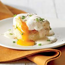 grits cakes with poached eggs and country gravy recipe myrecipes