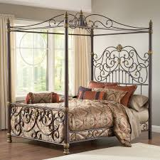 king size metal canopy bed with posts and intricate scrolling