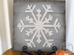 lake paints big white snowflake painted on wood pallet boards
