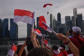 Singapore Flag Button Red Lions Drones And Guitar Rocking Granny 25 000 Strong Crowd