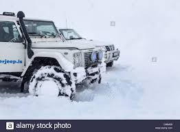 land rover snow land rover defender 4x4 vehicles in snow in iceland stock photo