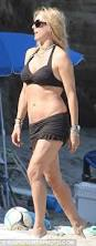 tea leoni flashes anchor tattoo as she and david duchovny