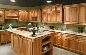 traditional l shaped kitchen design with oak cabinetry and island