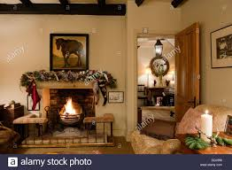 fireplace with club fender in cosy living room with howard style