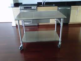 stainless steel kitchen table which can also be used as a kitchen