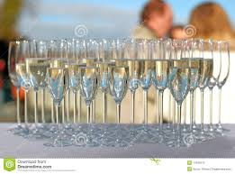 filled champagne glasses on a cocktail party royalty free stock