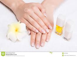 woman in a nail salon receiving manicure royalty free stock photos