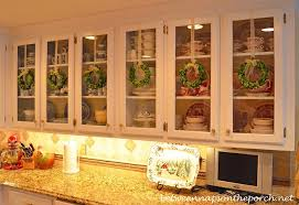 Christmas Decorating Ideas For Top Of Kitchen Cabinets by Decorate Kitchen Cabinets With Preserved Boxwood Wreaths For Christmas