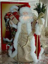 style santa tree topper by strongwater at