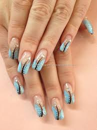 pale blue white and black freehand nail art over acrylic nails