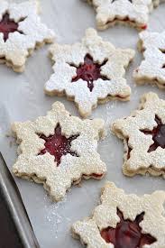 snowflake cookies raspberry linzer snowflake cookies the speckled palate