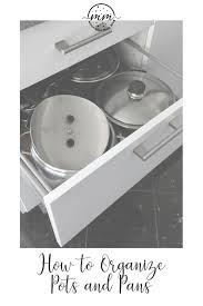how to organize pots and pans in a cupboard how to organize pots and pans in kitchen cabinets