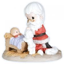 santa kneeling at the manger precious moments santa kneeling at manger figurine
