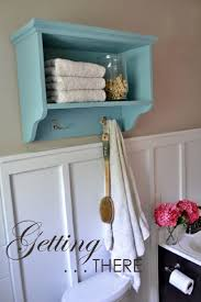 White Bathroom Shelf With Hooks by Over The Toilet Storage Ideas For Extra Space 2017