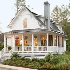 love the wraparound porch and big yard that is a must houses