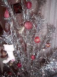 a sentimental life aluminum christmas tree dressed in pink