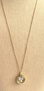 push present necklace pearl bird nest necklace gold jacaranda