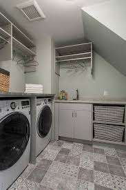 gray laundry room with gray patchwork tile floor transitional
