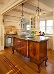 the centerpiece of the kitchen is an antique french cabinet