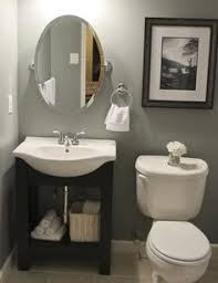 half bath makeover love the diy art the paper towel holder for