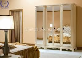 lemari pakain 4 pintu kaca desain terbaru produsen furniture jepara
