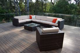 gorgeous wicker sectional with white cushions with glass square