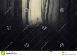 haunted forest with dark man silhouette on halloween stock photo