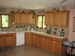 kitchen backsplash ideas with oak cabinets kitchens with oak cabinets and tile floors and surrounding