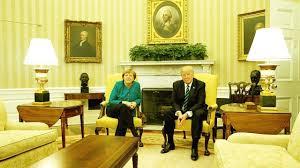 donald trump blanks angela merkel handshake offer at white house