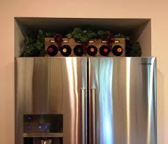 gael u0027s crafty treasures wine rack above the fridge