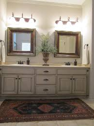 how to repaint bathroom cabinets love these painted bathroom cabinets and the lights what i would