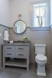 bathroom clawfoot tubs antlers and black wainscoting