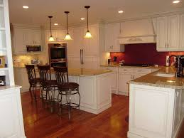 kitchen tiny counter under triple hanging lamp closed iron