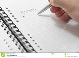 writing a strategy paper hand writing strategy list on white notebook stock photography royalty free stock photo